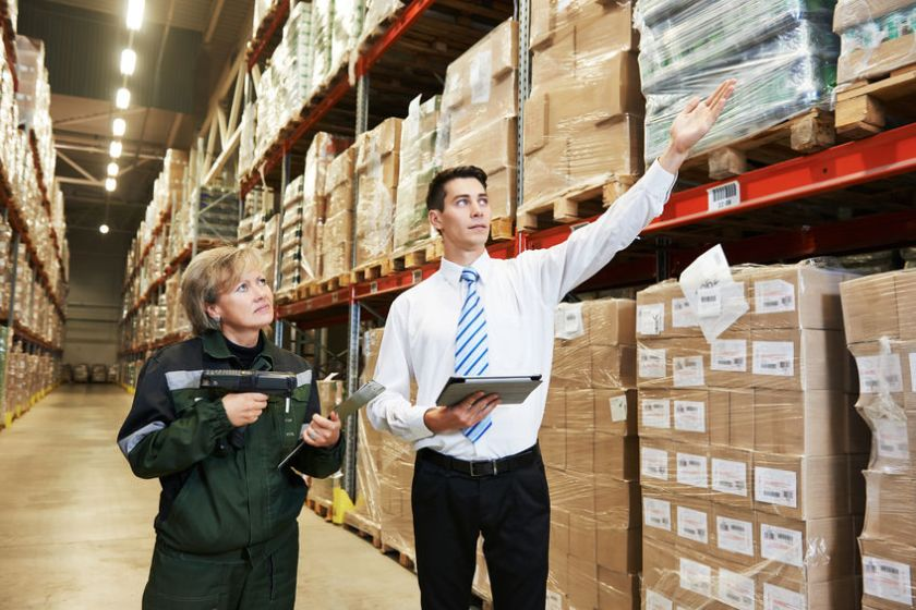 37640269 - manager and worker in warehouse with bar code scanner